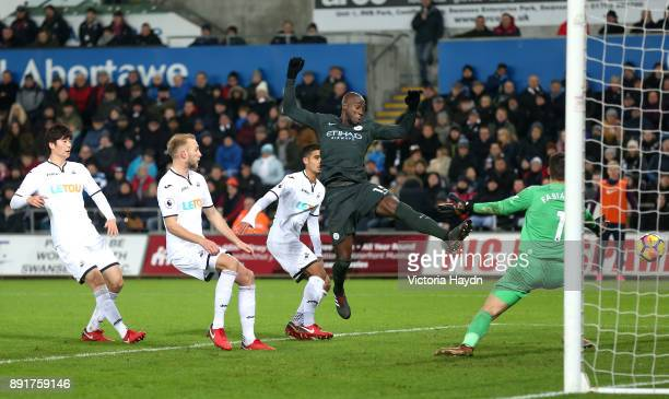 Eliaquim Mangala of Mancester City attempts to get a touch on the ball during the Premier League match between Swansea City and Manchester City at...