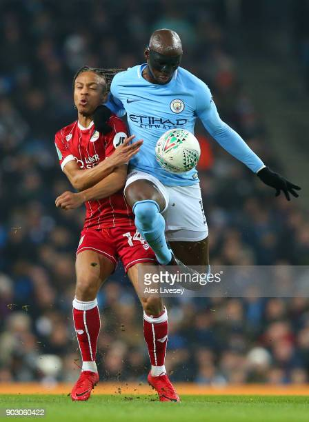 Eliaquim Mangala of Manchester City and Bobby Reid of Bristol City battle for the ball during the Carabao Cup SemiFinal First Leg match between...