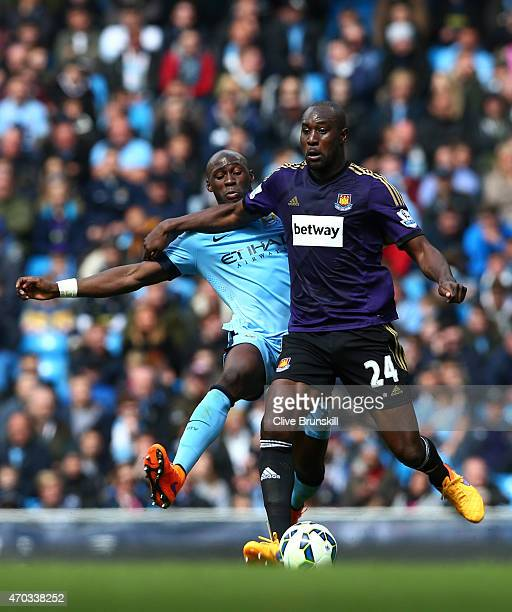 Eliaquim Mangala of Manchester City and Carlton Cole of West Ham battle for the ball during the Barclays Premier League match between Manchester City...