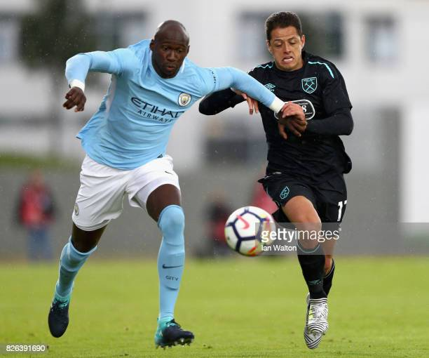 Eliaquim Mangala of Manchester City and Javier Hernandez of West Ham United battle for possession during a Pre Season Friendly between Manchester...