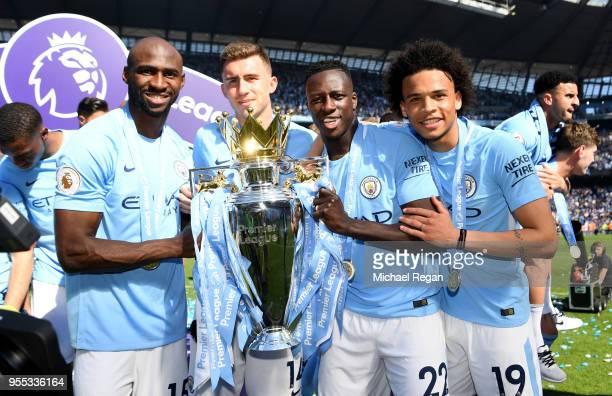 Eliaquim Mangala of Manchester City Aymeric Laporte of Manchester City Benjamin Mendy of Manchester City and Leroy Sane of Manchester City celebrate...
