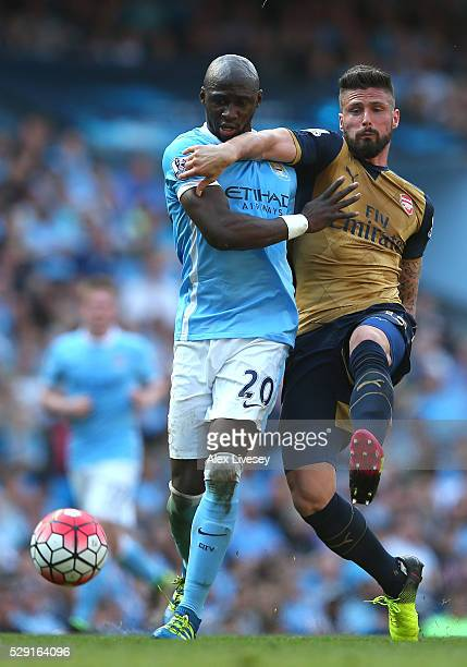 Eliaquim Mangala of Manchester City battles for the ball Olivier Giroud of Arsenal during the Barclays Premier League match between Manchester City...