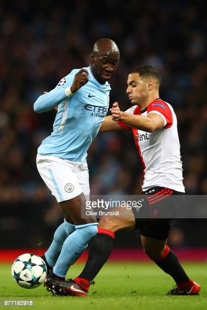 Eliaquim Mangala of Manchester City holds off Sofyan Amrabat of Feyenoord during the UEFA Champions League group F match between Manchester City and...