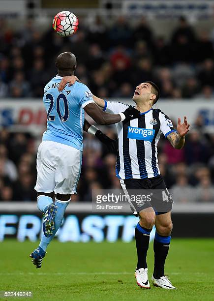 Eliaquim Mangala of Manchester City rises above Aleksandar Mitrovic of Newcastle United to win a header during the Barclays Premier League match...