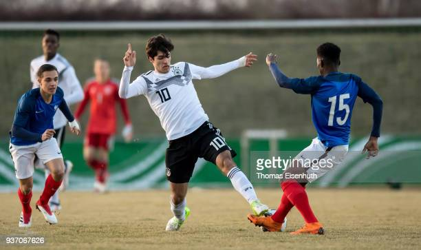 Elias Abouchabaka of Germany and Aurelien Tchouameni of France vie for the ball during the U18 international friendly match between Germany and...