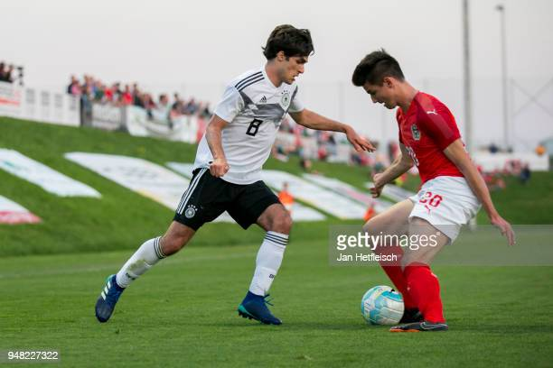 Elias Abouchabaka of Germany and Fabian Markl of Austria fight for the ball during the international friendly match between U18 Austria and U18...