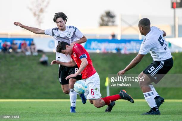 Elias Abouchabaka of Germany and Vesel Demaku of Austria fight for the ball during the International friendly match between U18 Austria and U18...