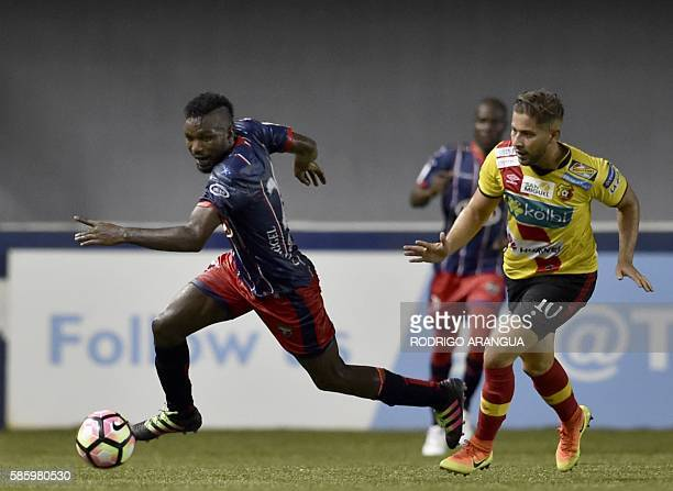 Elias Aguilar of Costa Rica's Herediano vies for the ball with Alexander Gonzalez of Panama's Plaza Amador during the CONCACAF Champions League at...
