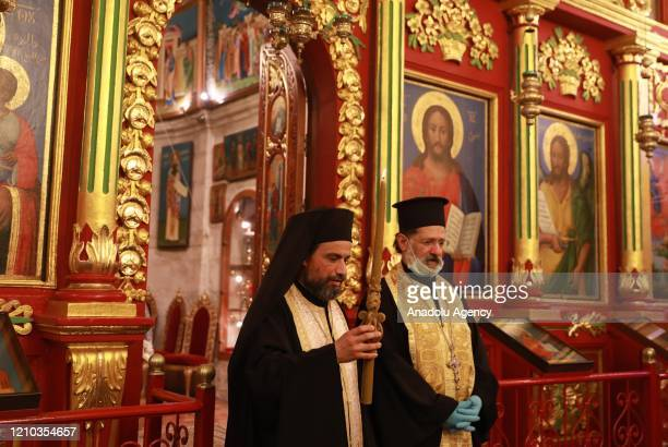Elias Awad, Priest of the Greek Orthodox Church takes the 'Holy Fire' brought from the Church of the Holy Sepulchre in Jerusalem, during Holy...