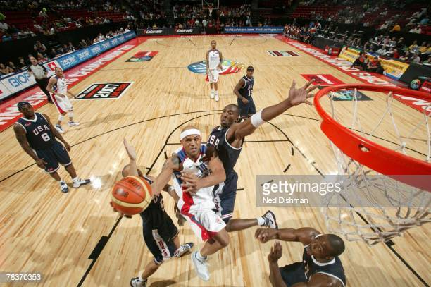 Elias Ayuso of Puerto Rico shoots against Kobe Bryant of the USA Men's Senior National Team during the second round of the 2007 FIBA Americas...