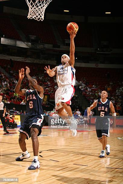 Elias Ayuso of Puerto Rico shoots against LeBron James of the USA Men's Senior National Team during the second round of the 2007 FIBA Americas...