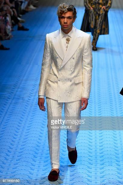 Elias Becker walks the runway at the Dolce Gabbana fashion show during Milan Men's Fashion Week Spring/Summer 2019 on June 16 2018 in Milan Italy