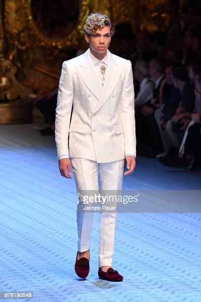 Elias Becker walks the runway at the Dolce Gabbana show during Milan Men's Fashion Week Spring/Summer 2019 on June 16 2018 in Milan Italy