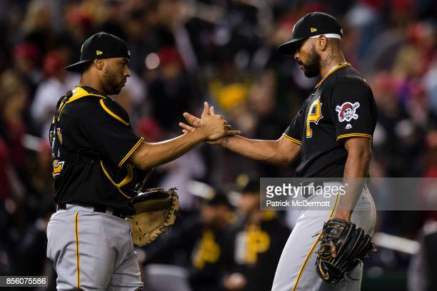 Elias Diaz and Felipe Rivero of the Pittsburgh Pirates celebrate after the Pirates defeated the Washington Nationals 41 at Nationals Park on...