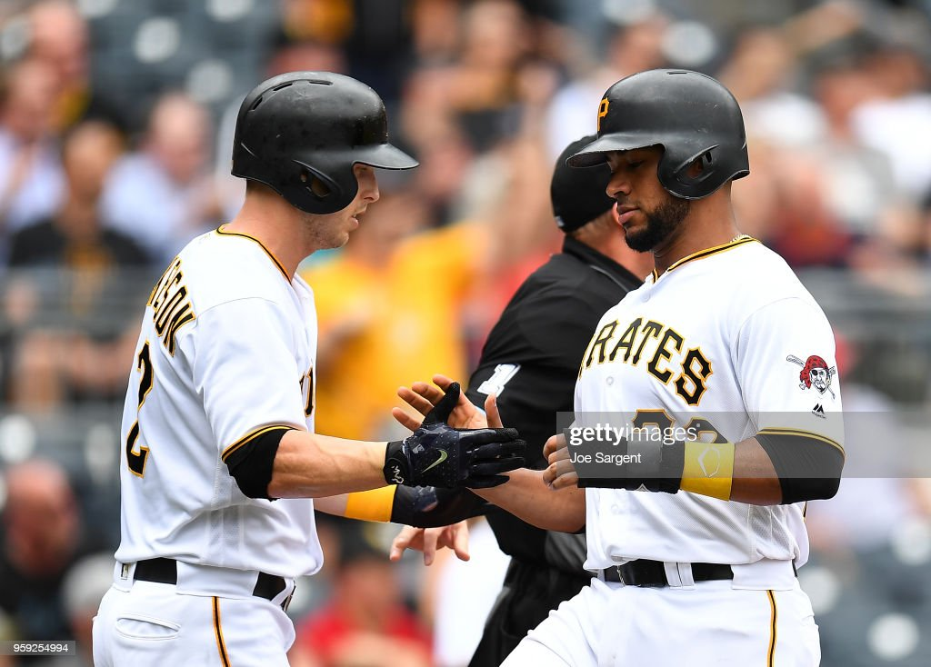 Elias Diaz #32 celebrates with Corey Dickerson #12 of the Pittsburgh Pirates after scoring in the second inning against the Chicago White Sox during inter-league play at PNC Park on May 16, 2018 in Pittsburgh, Pennsylvania.