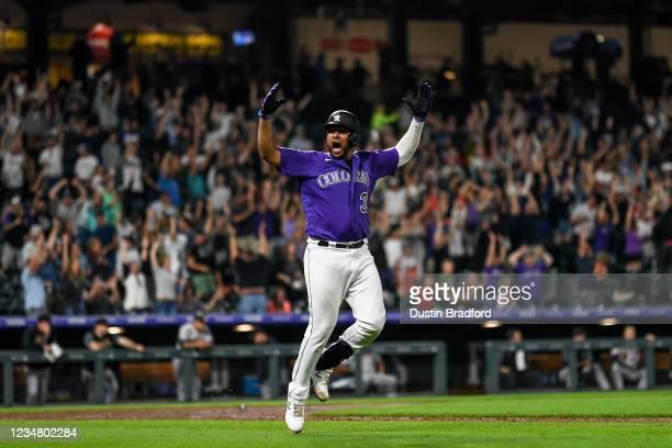 Elias Diaz of the Colorado Rockies celebrates after hitting a walk off three-run home run against the Arizona Diamondbacks at Coors Field on August...