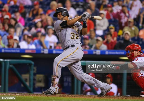 Elias Diaz of the Pittsburgh Pirates hits an RBI double in the eighth inning during a game against the Philadelphia Phillies at Citizens Bank Park on...