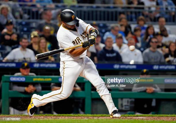 Elias Diaz of the Pittsburgh Pirates hits an RBI single in the third inning against the Arizona Diamondbacks at PNC Park on April 22 2019 in...