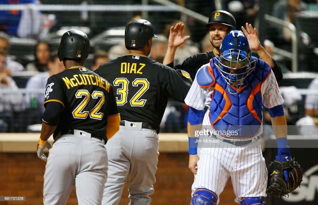 Elias Diaz #32 of the Pittsburgh Pirates reacts after his sixth inning three run home run with teammates Andrew McCutchen #22 and Jordy Mercer #10 as Travis d'Arnaud #18 of the New York Mets looks on at Citi Field on June 2, 2017 in the Flushing neighborhood of the Queens borough of New York City.