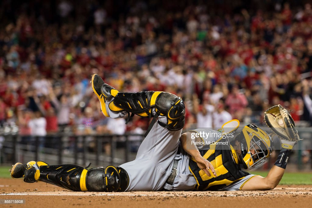 Elias Diaz #32 of the Pittsburgh Pirates reacts after tagging out Daniel Murphy #20 of the Washington Nationals (not pictured) at home plate in the first inning at Nationals Park on September 29, 2017 in Washington, DC.