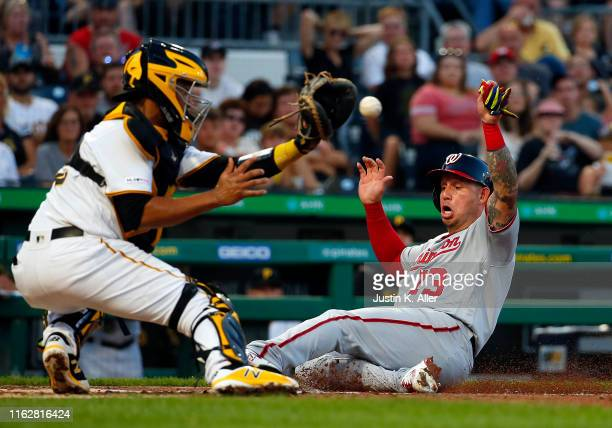 Elias Diaz of the Pittsburgh Pirates tags out Asdrubal Cabrera of the Washington Nationals in the second inning at PNC Park on August 19, 2019 in...
