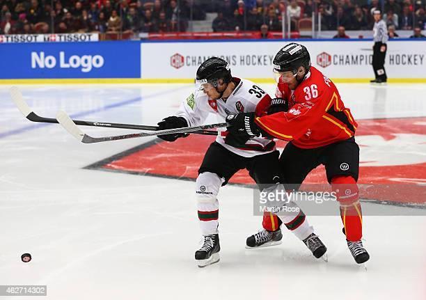Elias Falth of Frolunda Gothenburg battles with Niklas Fogstrom of Lulea Hockey during the Champions Hockey League Final match between Lulea Hockey...