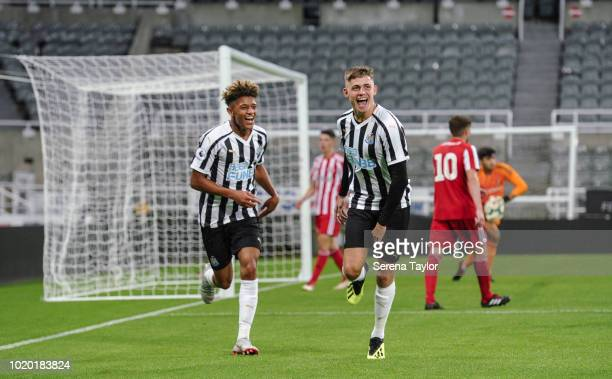 Elias Fritjof Sorensen of Newcastle United celebrates with Adam Wilson after scores Newcastle's fifth goal during the Premier League 2 Match between...