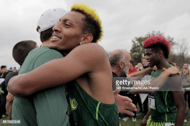 Elias Gedyon of Adams State University embraces a teammate during the Division II Men's Cross Country Championship held at the Angel Mounds on...