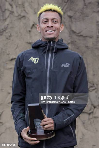 Elias Gedyon of Adams State University is photographed with his seventh place trophy Division II Men's Cross Country Championship held at the Angel...