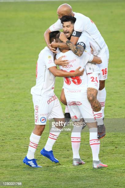Elias Gomez of Argentinos Juniors celebrates with teammates after scoring the first goal of his team during a match between Argentinos Juniors and...