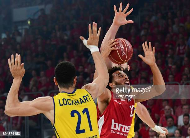 Elias Harris of Bamberg challenges Dominic Lockhart of Oldenburg during game 3 of the 2017 BBL Finals at Brose Arena on June 11 2017 in Bamberg...
