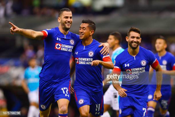 Elias Hernandez of Cruz Azul celebrates with Edgar Mendez after scoring the first goal of his team with teammates during the quarter final second leg...