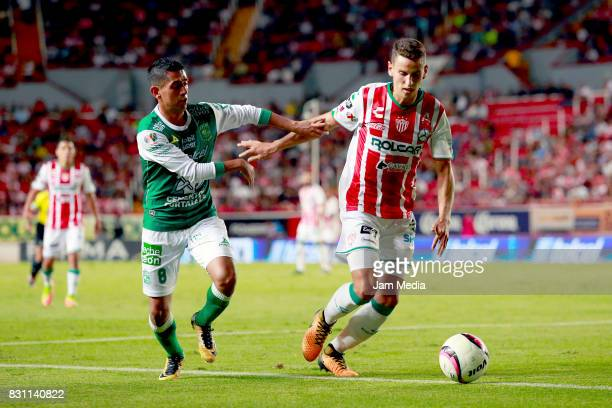 Elias Hernandez of Leon and Igor Lichnovsky of Necaxa fight for the ball during the 4th round match between Necaxa and Leon as part of the Torneo...