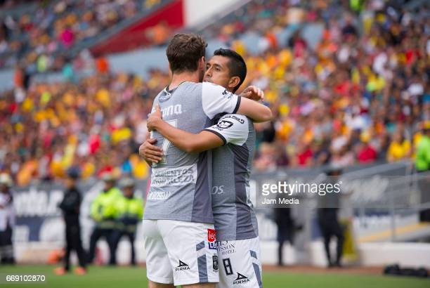 Elias Hernandez of Leon celebrates with teammate after scoring the first goal of his team during the 14th round match between Morelia and Leon as...