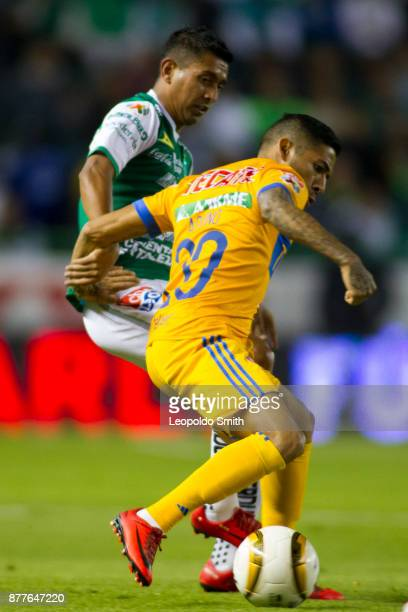 Elias Hernandez of Leon figths for the ball with Javier Aquino of Tigres during the quarter finals first leg match between Leon and Tigres UANL as...