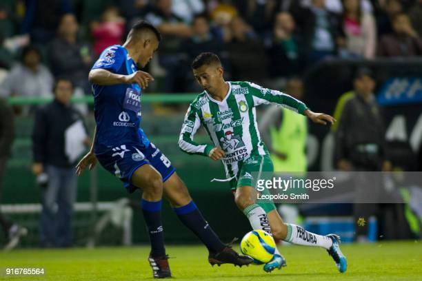 Elias Hernandez of Leon figths the ball with Anderson Santamaria of Puebla during the 6th round match between Leon and Puebla as part of the Torneo...