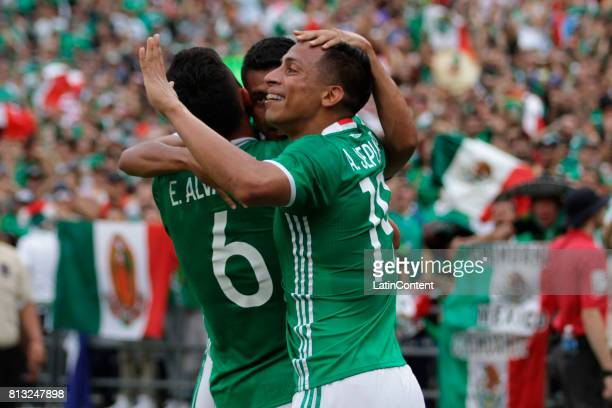 Elias Hernandez of Mexico celebrates with teammates after scoring the second goal for his team during a Group C match between Mexico and El Salvador...