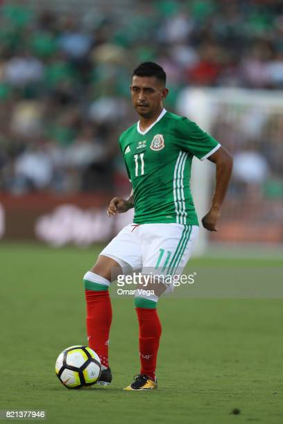 Elias Hernandez of Mexico drives the ball during a match between Mexico and Jamaica as part of CONCACAF Gold Cup Semifinal at Rose Bowl Stadium on...