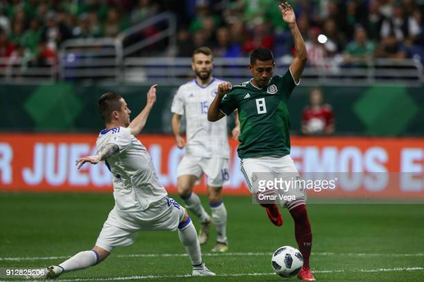Elias Hernandez of Mexico fights for the ball with Almir Bekic of Bosnia during the friendly match between Mexico and Bosnia and Herzegovina at...