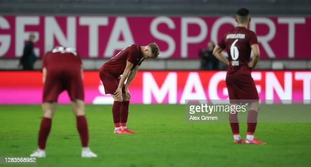 Elias Huth, Philipp Hercher and Hikmet Ciftci of Kaiserslautern react after the 3. Liga match between 1. FC Kaiserslautern and Hansa Rostock at...