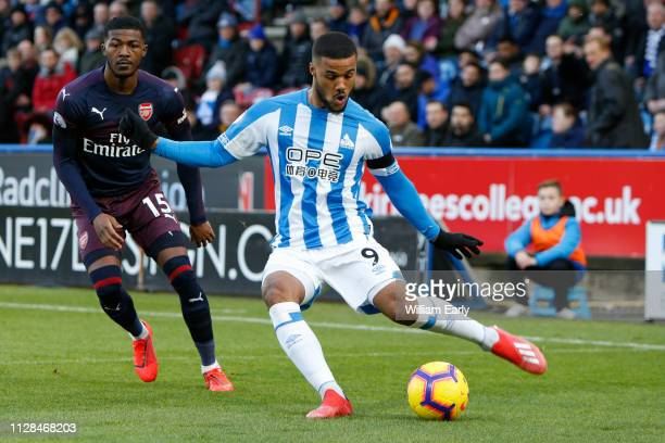 Elias Kachunga of Huddersfield Town and Ainsley MaitlandNiles of Arsenal during the Premier League match between Huddersfield Town and Arsenal FC at...