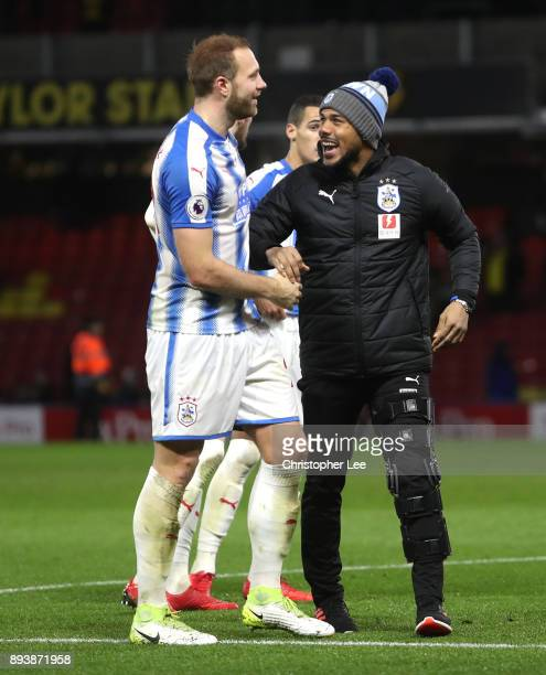 Elias Kachunga of Huddersfield Town and Laurent Depoitre of Huddersfield Town celebrate victory after the Premier League match between Watford and...