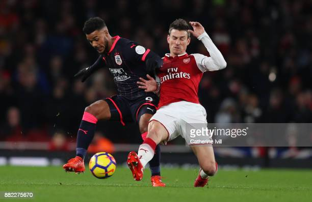 Elias Kachunga of Huddersfield Town and Laurent Koscielny of Arsenal during the Premier League match between Arsenal and Huddersfield Town at...