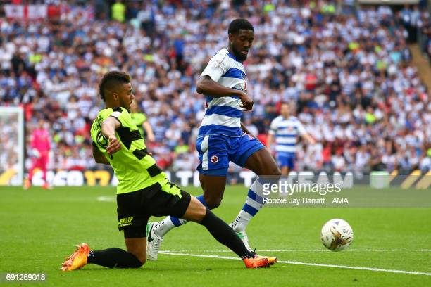 Elias Kachunga of Huddersfield Town and Tyler Blackett of Reading during the Sky Bet Championship Play Off Final match between Reading and...