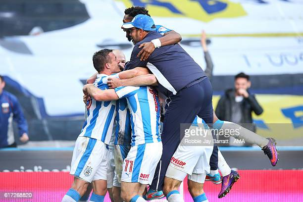 Elias Kachunga of Huddersfield Town celebrates after scoring a goal to make it 10 as David Wagner head coach / manager of Huddersfield Town runs to...
