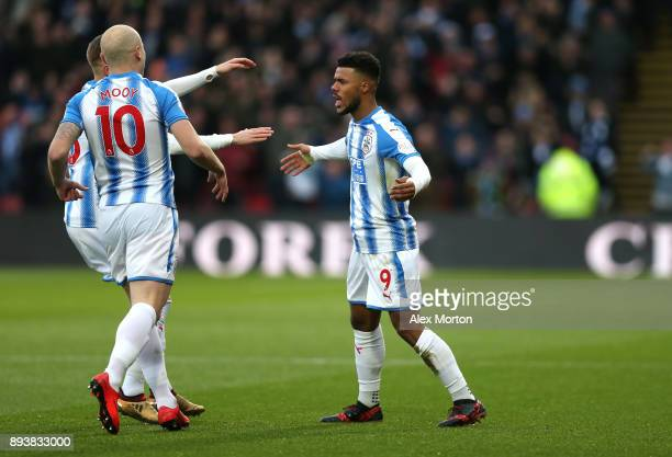 Elias Kachunga of Huddersfield Town celebrates after scoring his sides first goal with Aaron Mooy of Huddersfield Town during the Premier League...