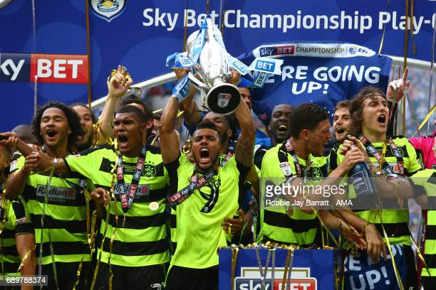 Elias Kachunga of Huddersfield Town celebrates by lifting the Sky Bet Play Off Final trophy during the Sky Bet Championship Play Off Final match...