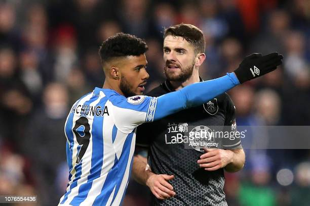 Elias Kachunga of Huddersfield Town gestures towards the touchline as Robbie Brady of Burnley is shown a red card during the Premier League match...