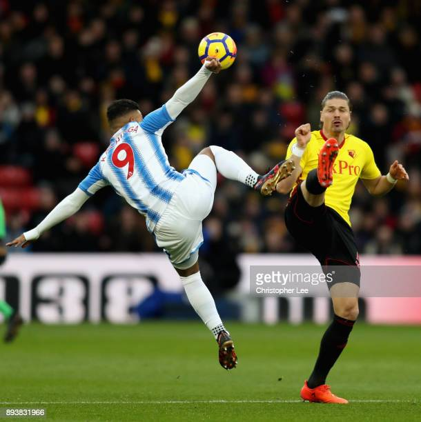 Elias Kachunga of Huddersfield Town is challenged by Sebastian Prodl of Watford during the Premier League match between Watford and Huddersfield Town...