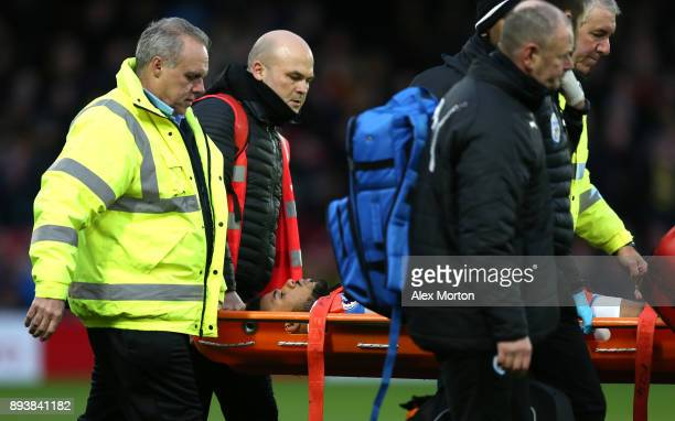 Elias Kachunga of Huddersfield Town is stretcherd off during the Premier League match between Watford and Huddersfield Town at Vicarage Road on...